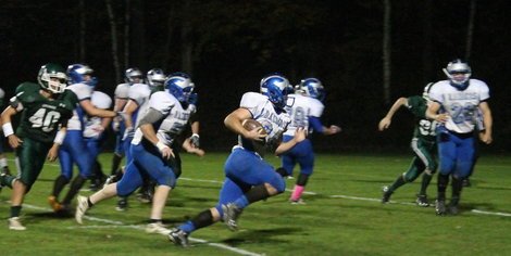 Adam Gowans runs for one of four touchdowns on Friday night.